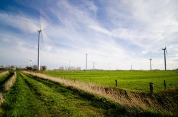 Wind Farm on Green Grass Pastures