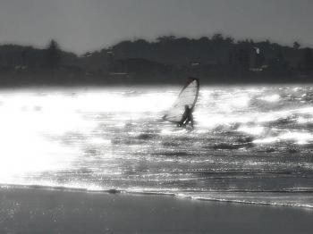Windsurfer and Beach