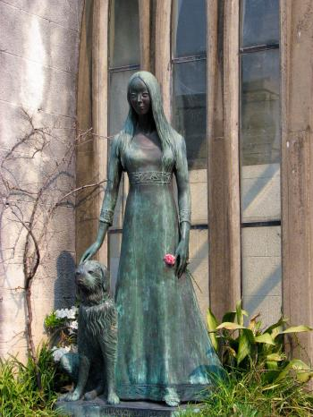 Woman and dog statue