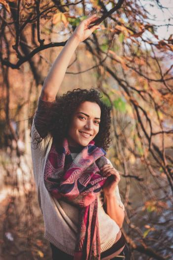 Woman Beside A Tree