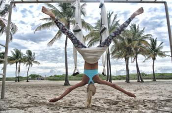 Woman Doing Anti-Gravity Yoga