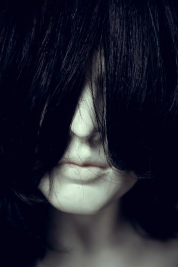 Woman Face Covered With Hair
