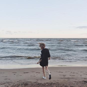 Woman Going Toward the Sea Under Clear Skies