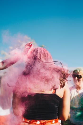 Woman Hair Covered With Pink Powder