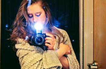 Woman Holding a Black Dslr Camera