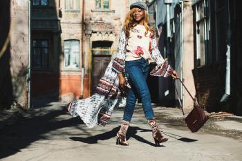 Woman Holding Bag Near Buildings