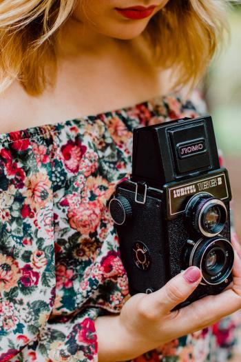 Woman Holding Black Nomo Vintage Camera