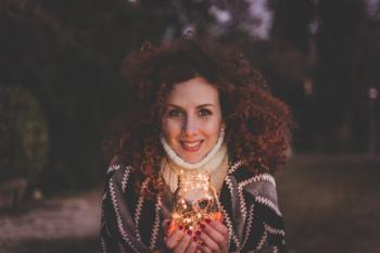 Woman Holding Glass Jar Lantern