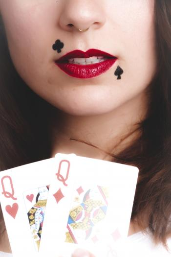 Woman Holding Queen of Hearts and Diamonds