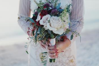 Woman Holding Red and White Rose Bouquet
