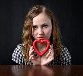 Woman Holding Red Heart Shape Ornament