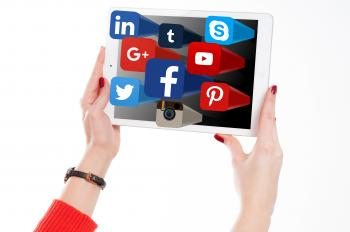 Woman Holding Tablet with Social Media Networks Logos