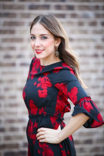 Woman in Black and Red Floral Half-sleeved Dress
