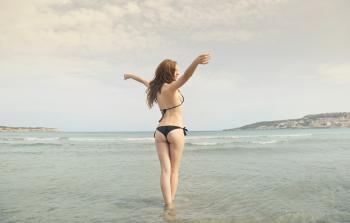 Woman in Black Bikini Standing on Shore