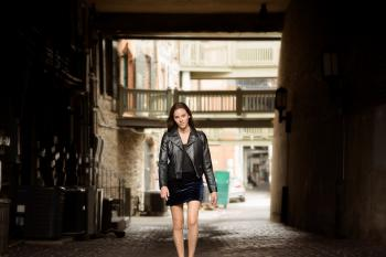 Woman in Black Leather Jacket and Skirt