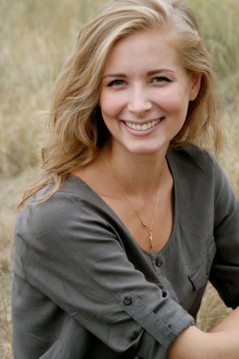 Woman in Black Scoop Neck Shirt Smiling