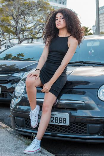 Woman in Black Spaghetti Strap Dress and White Converse All-star High-top