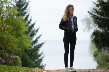 Woman in Black Winter Jacket Near Trees