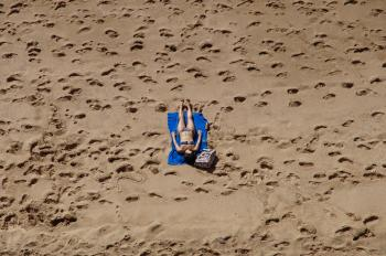 Woman in Blue 2-piece Set Lying on Blue Blanket at Beach on Aerial Photo