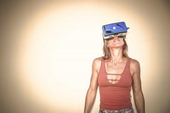 Woman in Brown Cages Sleeveless Top and Blue Virtual Reality Headset