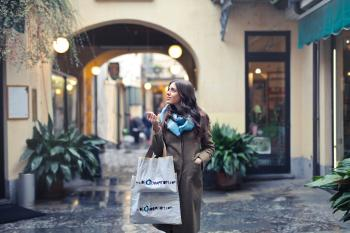 Woman in Brown Full-zip Long-sleeved Coat With Tote Bags