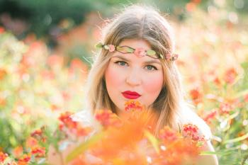 Woman in Flower Field Wearing Headband