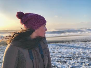 Woman in Gray Full-zip Jacket on Snowy Field