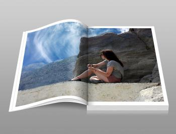 Woman in Gray Shirt Sitting over Brown Formation of Rock during Daytime Book