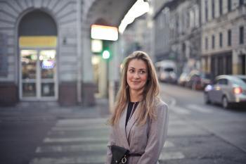 Woman in Gray Suit Jacket Near Gray Car
