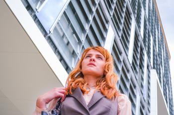 Woman in Grey Blazer Low Angle Photography Near Building