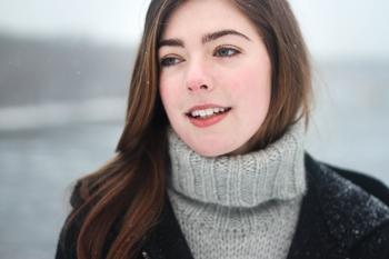Woman in Grey Knit Sweater