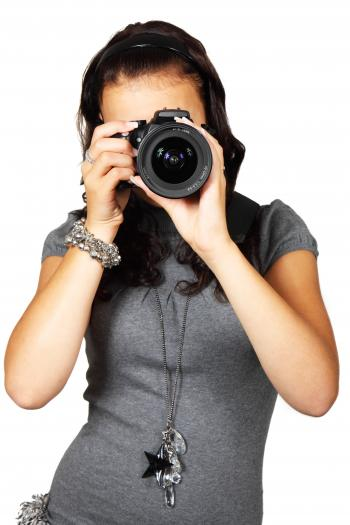 Woman in Grey T-Shirt Using Black DSLR Camera