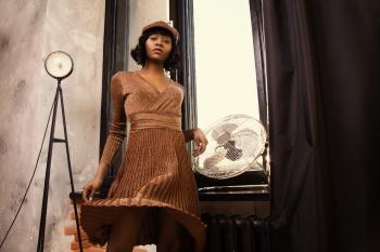 Woman in Long-sleeved Midi Dress Standing Near on Wall-mounted Fan