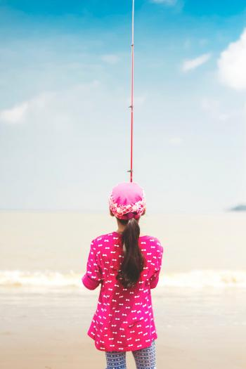 Woman in Pink Long-sleeved Shirt Holding Red Fishing Rod