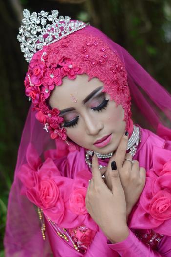 Woman In Pink Traditional Dress Wearing A Tiara