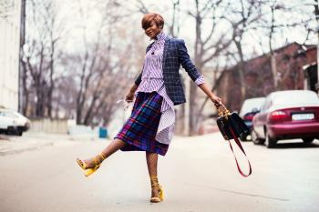 Woman in Purple Top and Plaid Skirt Near Car