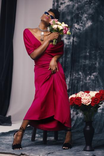 Woman in Red Dress Holding Flower