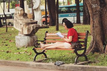 Woman In Red Shirt Sitting On Bench