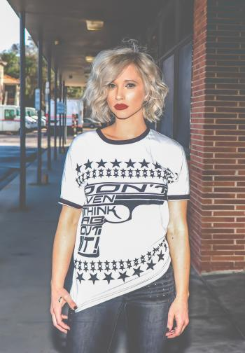 Woman in White and Black Gun-printed Crew-neck Shirt