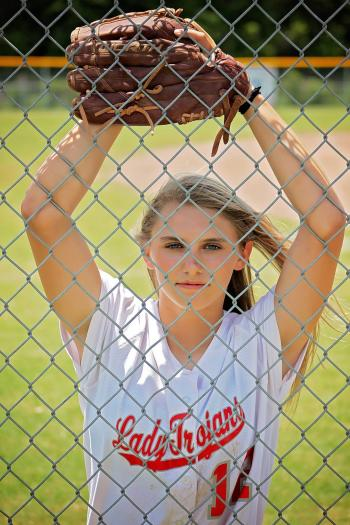 Woman in White Crew Neck T-shirt With Baseball Mitt in Front of Fence