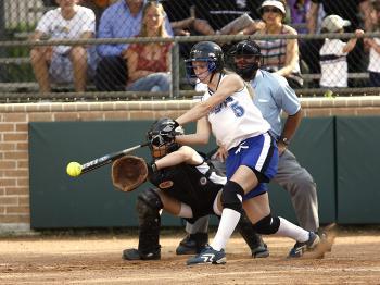 Woman in White Jersey Shirt Playing Baseball during Daytime