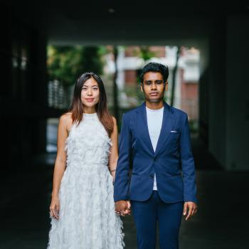 Woman in White Sleeveless Dress and Man on Blue Blazer