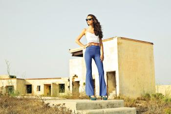Woman in White Spaghetti Strap Crop Top and Blue Pants