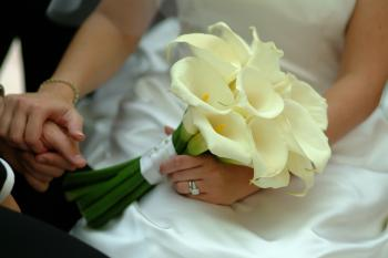 Woman In White Wedding Gown Holding White Petaled Flowers
