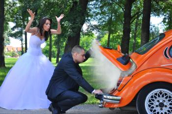 Woman in White Wedding Gown Near Orange Car