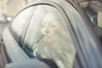 Woman Inside the Black Sedan at Daytime