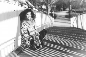 Woman Leaning Near White Metal Rail on Bridge
