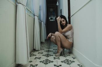 Woman Leaning on Wall