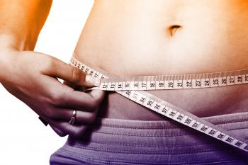 Woman Measuring Waistline - How to Lose Weight Fast