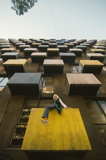 Woman On A Building Balcony